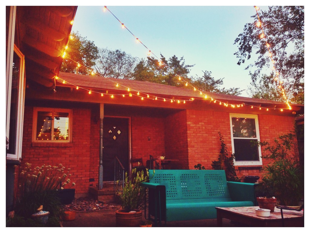 Twinkle lights and my favorite vintage glider. It helps me pretend I live in Austin.